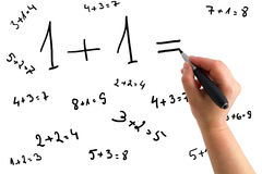 Mano che dissipa le equazioni matematiche Fotografia Stock Libera da Diritti