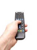 Mano che giudica una TV a distanza immagine stock libera da diritti