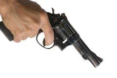 Mano che indica una pistola all'obiettivo Immagini Stock Libere da Diritti