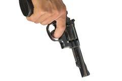 Mano che indica una pistola all'obiettivo Fotografia Stock Libera da Diritti