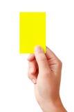 Mano che mostra scheda gialla Fotografie Stock