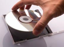 Mano che prende il disco di DVD Fotografia Stock Libera da Diritti