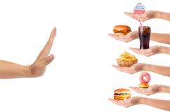 Mano che rifiuta alimenti industriali Fotografia Stock