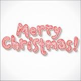 Mano che segna il segno con lettere decorato di Buon Natale Immagini Stock Libere da Diritti