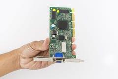 Mano che tiene il chip di IC Fotografie Stock Libere da Diritti