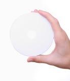 Mano che tiene il disco cd in bianco bianco del dvd Fotografia Stock Libera da Diritti