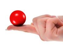 Mano che tiene la sfera in bianco di colore rosso 3D Fotografia Stock Libera da Diritti