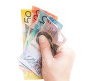 Mano che tiene le banconote australiane Immagini Stock