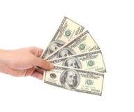 Mano che tiene le banconote in dollari americane. Fotografie Stock