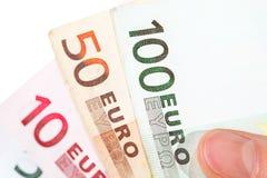 Mano che tiene le euro banconote Fotografia Stock