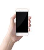 Mano che tiene lo smartphone bianco Immagine Stock