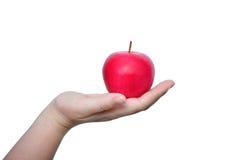 Mano che tiene mela rossa Fotografie Stock Libere da Diritti