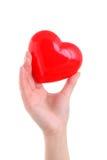 Mano che tiene simbolo rosso del cuore Immagini Stock Libere da Diritti