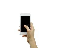Mano che tiene telefono bianco su bianco Immagine Stock