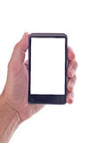 Mano che tiene telefono cellulare generico con lo schermo in bianco Fotografie Stock Libere da Diritti