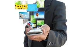 Mano che tiene telefono mobile fotografia stock