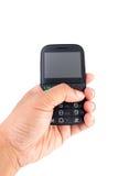 Mano che tiene telefono mobile Immagini Stock