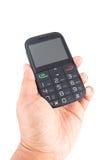 Mano che tiene telefono mobile Immagine Stock