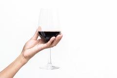 Mano che tiene un bicchiere di vino Fotografia Stock