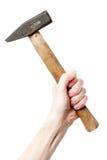 Mano che tiene un grande martello Fotografia Stock