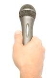 Mano che tiene un microfono Fotografie Stock