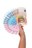 Mano che tiene un ventilatore di euro banconote. Fotografie Stock Libere da Diritti