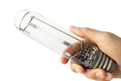 Mano che tiene una lampada a scarica ad alta intensità utilizzata Fotografie Stock