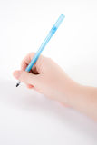 Mano che tiene una penna Immagini Stock Libere da Diritti