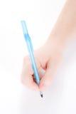 Mano che tiene una penna Fotografie Stock