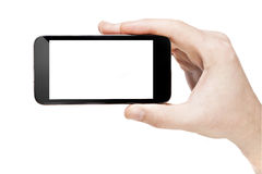 Mano che tiene uno Smart Phone con lo schermo in bianco Immagini Stock