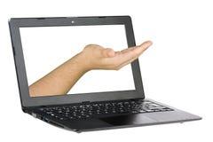 Mano che viene fuori schermo del computer portatile del computer isolato Fotografie Stock Libere da Diritti