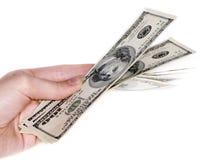 Mano con $100 billetes de banco Fotografía de archivo libre de regalías