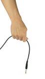 Mano con audio cavo isolato su fondo bianco Fotografie Stock Libere da Diritti