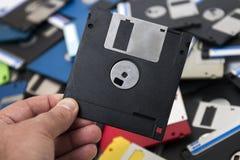 mano con del disco blando Fotos de archivo