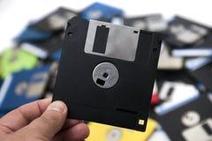 mano con del disco blando Imágenes de archivo libres de regalías