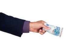 Mano con el billete de banco del euro veinte Imagenes de archivo