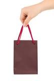 Mano con el bolso de compras Fotografía de archivo libre de regalías