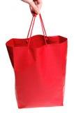 Mano con el bolso rojo imagenes de archivo