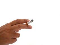 Mano con el cigarrillo Imagen de archivo libre de regalías