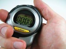 Mano con el cronómetro de Digitaces Fotos de archivo