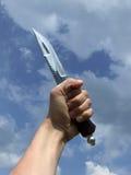 Mano con el cuchillo Fotos de archivo libres de regalías