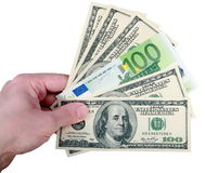 Mano con el dólar y el euro en blanco Imagen de archivo libre de regalías