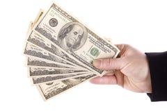 Mano con el dinero aventado foto de archivo