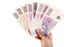 Mano con el dinero checo Imagenes de archivo