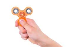 Mano con el juguete del hilandero Imagen de archivo libre de regalías