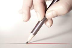 Mano con el lápiz imagen de archivo