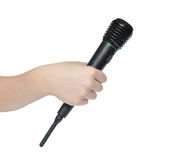 Mano con el micrófono Foto de archivo libre de regalías