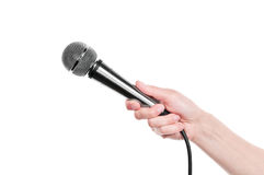 Mano con el micrófono fotos de archivo