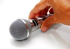 Mano con el micrófono Imágenes de archivo libres de regalías
