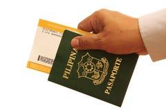 Mano con el pasaporte Foto de archivo libre de regalías